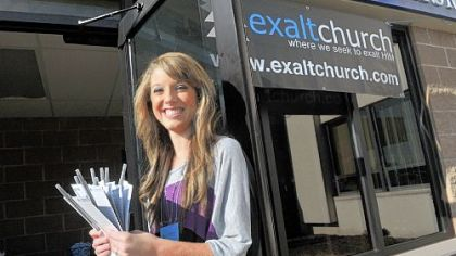 Angellia Logsdon welcomes people to Exalt Church at Wilson Christian Academy on Sunday.