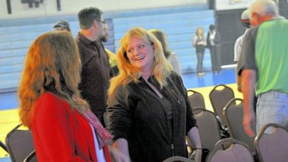 "Emily McCowan, center, of Jefferson Hills talks during the ""meet and greet"" session of Exalt Church services, held at Wilson Christian Academy."
