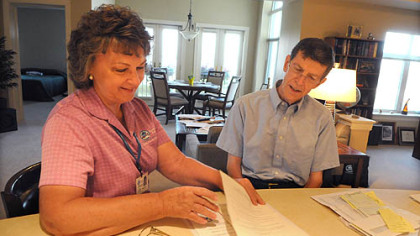 Comfort Keepers' caregiver Margaret Battle works with Robert Stevenson.