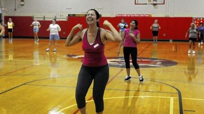 Harshita Gurnani, center, of Fox Chapel takes part in a Zumba class offered by the adult education program at Fox Chapel Area High School.