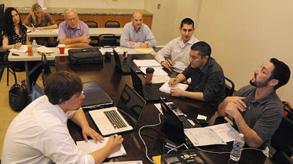 A training meeting for new associates is held by Chris Williams (far right)at American Income Life Arias Agencies.