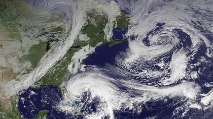 In this image taken by NOAA today, Hurricane Sandy is seen in the center bottom.