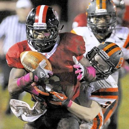 Aliquippa's Dravon Henry picks up a first down against Beaver Falls last week.