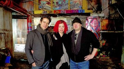 "Directors Tom Tykwer, left, Lana Wachowski and Andy Wachowski joined forces for ""Cloud Atlas."""