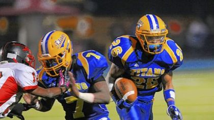 West Mifflin's Jimmy Wheeler, following a block from teammate Diallo Mitchell, is second in the WPIAL in rushing with 1,543 yards.