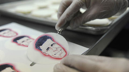 Alan Phillips applies edible paper with caricatures of the presidential candidates to shortbread cookies at Bethel Bakery in Bethel Park on Wednesday.