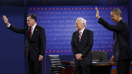 Moderator Bob Schieffer, Mitt Romney, and President Barack Obama  wave to the audience during the third presidential debate at Lynn University, Oct. 22 in Boca Raton, Fla.