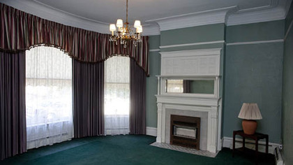 The front sitting room features a fireplace.