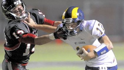 Mt. Lebanon quarterback Tyler Roth runs against Upper St. Clair's J.J. Conn in the first half at Upper St. Clair.