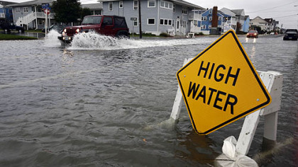 A car goes through high waters as Hurricane Sandy bears down Sunday in Ocean City, Md.