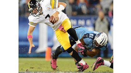 The Titans Derrick Morgan sacks Steelers quarterback Ben Roethlisberger.