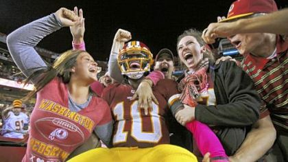 Robert Griffin III celebrates with happy Redskins fans at FedEx Field after a 76-yard touchdown run against Minnesota Oct. 14 == the longest scoring run by an NFL quarterback since Kordell Stewart went 80 yards in 1996.