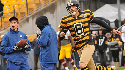 Steelers kicker Shaun Suisham, decked out in the retro Steelers uniform, practices kicks before the start of the Steelers-Redskins game at Heinz Field.