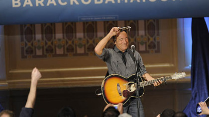 Bruce Springsteen finishes a performance at Soldiers & Sailors, Oakland, as part of a rally organized by Obama for America.