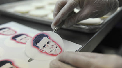 Alan Phillips applies edible paper with caricatures of the presidential candidates to shortbread cookies at Bethel Bakery in Bethel Park.