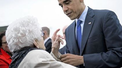 President Barack Obama speaks with a supporter Wednesday after arriving at Eastern Iowa Airport in Mt. Vernon, Iowa. Mr. Obama traveled to Iowa and Ohio to attend campaign rallies in the two swing states.