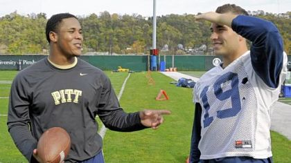 Former Pitt football player Derrick Burns, left, talks to his friend Ethan Brown at practice Tuesday on the South Side. Burns, who was a redshirt freshman fullback, suffered a stroke in the spring. The 20-year-old is now directing his energies toward helping people who survived strokes and other brain injuries.