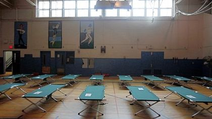 Cots are set up Sunday in the gymnasium at Roxborough High School, designated a Red Cross shelter, in Philadelphia.