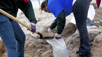 People make sandbags Sunday as Hurricane Sandy approaches in the Rockaway Beach neighborhood of the Queens borough of New York City. New York Mayor Michael Bloomberg announced a mandatory evacuation of low-lying coastal areas of the city.