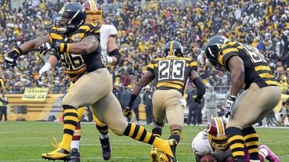 Steelers' Ziggy Hood celebrates after taking down Redskins quarterback Robert Griffin III in the second quarter Sunday at Heinz Field. Griffin managed only 8 rushing yards on the game.