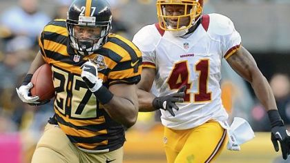 Running back Jonathan Dwyer picks up 10 yards against the Redskins in the third quarter Sunday at Heinz Field. Dwyer ran for a game-high 107 yards.