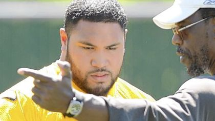 Steelers defensive lineman Alameda Ta'amu, left, with defensive line coach John Mitchell
