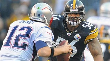 Steelers linebacker LaMarr Woodley sacks Patriots quarterback Tom Brady in the first half of a game at Heinz Field.
