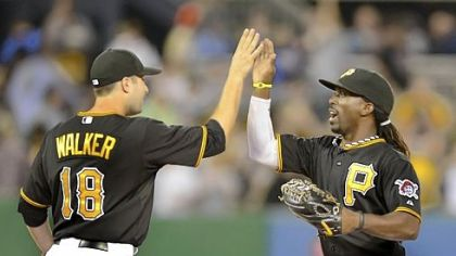 Pirates second baseman Neil Walker celebrates with center fielder Andrew McCutchen after beating the Marlins.