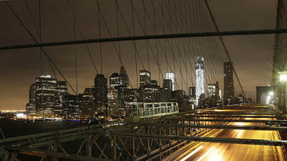 Cars streak across the Brooklyn Bridge as wind and rain from Hurricane Sandy arrive, Monday, Oct. 29, 2012 in New York(AP Photo/)