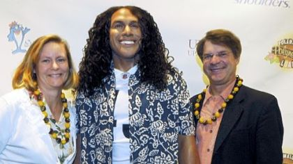 Jan and Richard Piacentini with a statue of Troy Polamalu.