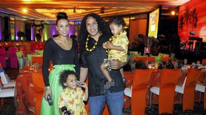 Troy Polamalu and his wife Theodora, with kids Paisios, and Troy holding Ephraim.