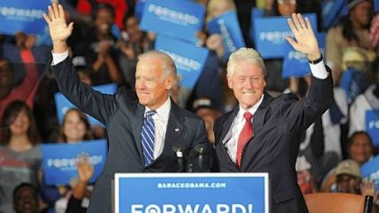 Vice President Joe Biden and former President Bill Clinton greet the crowd Monday at the Covelli Centre in Youngstown, Ohio.