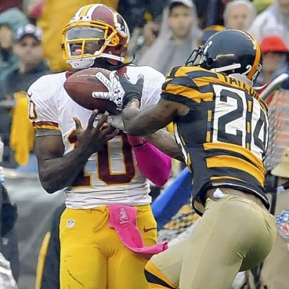 Steelers&#039;&#039; Ike Taylor breaks up a pass intended for Robert Griffin III in the second quarter Sunday at Heinz Field.