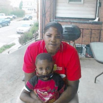 Conekia Finney in front of her mother&#039;s home with her son, Hezekiah, earlier this year.