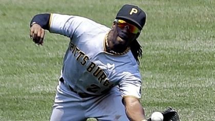 Pirates center fielder Andrew McCutchen dives and catches a ball in St. Louis in a season in which his defense was rewarded with his first Gold Glove.