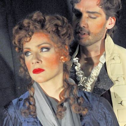 Don Giovanni is portrayed by Michael Todd Simpson, seen here with Jennifer Holloway who plays Donna Elvira.