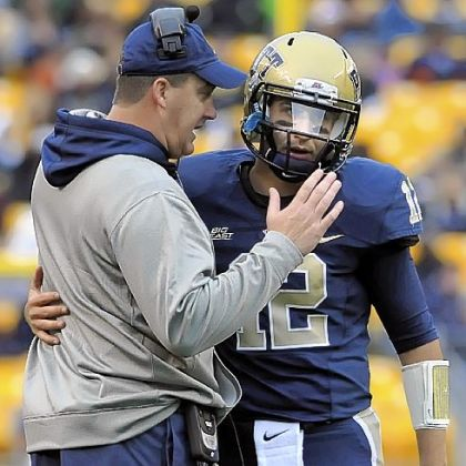 Pitt head coach Paul Chryst talks with quarterback Tino Sunseri near the end of the second quarter against Temple at Heinz Field Saturday.