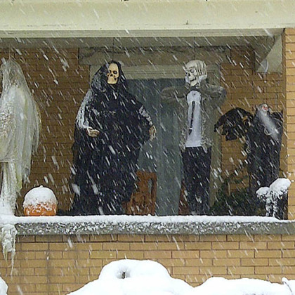 Halloween decorations are seen during a snowstorm, Tuesday, Oct. 30, 2012, in Elkins, W.Va.