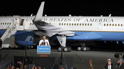Barack Obama speaks in front of Air Force One at a campaign event at Burke Lakefront Airport in Cleveland.