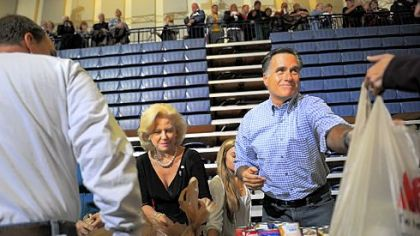 Republican presidential candidate Mitt Romney helps collect and pack donated goods at a storm relief center in Kettering, Ohio, near Dayton.