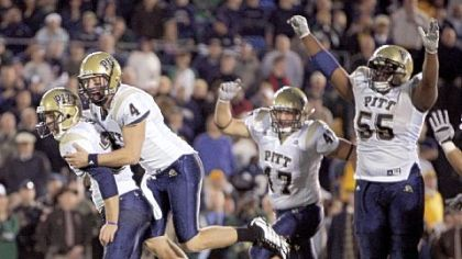 Pitt kicker Conor Lee,left, celebrates with holder Andrew Janocko (4) after kicking the winning field goal in the fourth overtime period against Notre Dame in 2008.