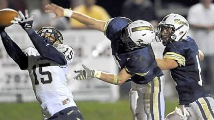 Franklin Regional&#039;s Charan Singh pulls in a pass for a touchdown as Knoch&#039;s Ben Tackett and Dakota Bruggeman defend during a game played Oct. 4.