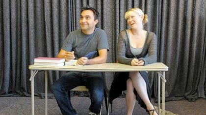 "John Biles, left, and Holly Bryant Scott rehearse ""The Last Five Years,"" a musical that is being performed at the new location of Off the Wall Theater in Carnegie. Mr. Biles, a native of Shaler who has returned to the region after living in New York, is producing the play as well as performing in it."