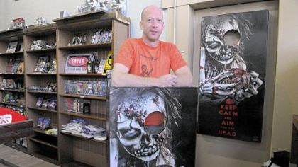 Chuck Cramer, co-owner of House of the Dead at Main and Butler streets in Lawrenceville, shows off his little shop of horrors.