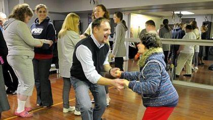 Chris Roth, owner-director of Steel City Ballroom, dances with Paula Karafa during a session sponsored by Yes, You Can Dance! at the Steel City Ballroom in Mt. Lebanon. The class provides dance opportunities for youths and young adults with special needs.
