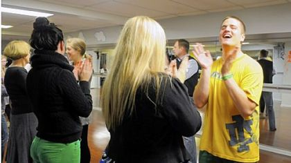 "James ""J.D."" Keller applauds after a dance during the dance class Sunday at Steel City Ballroom in Mt. Lebanon."