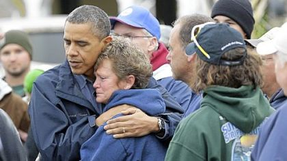 President Barack Obama embraces Donna Vanzant during a tour of a neighborhood effected by superstorm Sandy, in Brigantine, N.J.