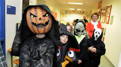 Alex Owczarzak, a third-grader at West View Elementary School in Ross, walks with his class through the hallways for the school's Halloween parade Wednesday.  The rain kept the parade indoors.