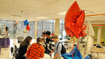 Students mark their ballots for the mock election in Upper St. Clair's cafeteria.