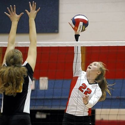 Fox Chapel's Megan Hollingsworth goes for a kill against North Allegheny Thursday night.